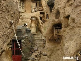Unique houses carved into the rock village Kandovan, Iran, Picture